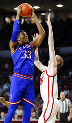 Kansas forward David McCormack (33) shoots as Oklahoma forward Brady Manek (35) defends in the first half of an NCAA college basketball game in Norman, Okla., Tuesday, March 5, 2019. (AP Photo/Nate Billings)