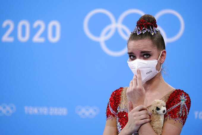 Dina Averina, of the Russian Olympic Committee, waits for her final score after competing in the individual all-around rhythmic gymnastics final at the 2020 Summer Olympics, Saturday, Aug. 7, 2021, in Tokyo, Japan. Averina won the silver medal in the event. (AP Photo/Ashley Landis)