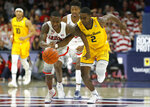 Arizona guard Justin Coleman and California guard Juhwan Harris-Dyson (2) races for the ball during the first half of an NCAA college basketball game Thursday, Feb. 21, 2019, in Tucson, Ariz. (AP Photo/Rick Scuteri)
