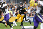 Pittsburgh Steelers backup quarterback Devlin Hodges (6) scrambles for a first down in the second half of an NFL football game, Sunday, Oct. 6, 2019, in Pittsburgh. The Ravens won 26-23 in overtime. (AP Photo/Don Wright)