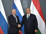 Hungarian Prime Minister Viktor Orban, right, and Russian President Vladimir Putin pose for a photo prior to their talks in Budapest, Hungary, Wednesday, Oct. 30, 2019. Hungary has maintained friendly ties with Russia and long criticized the European Union's sanctions against Moscow. (Alexei Nikolsky, Sputnik, Kremlin Pool Photo via AP)