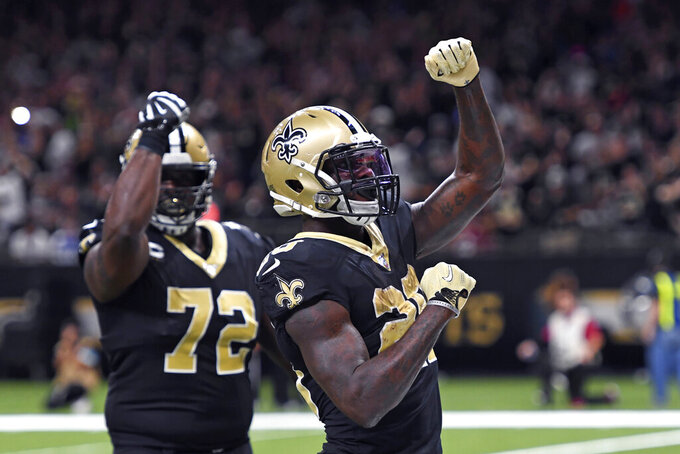 New Orleans Saints running back Latavius Murray celebrates his touchdown with offensive tackle Terron Armstead (72) in the first half of an NFL football game against the Arizona Cardinals in New Orleans, Sunday, Oct. 27, 2019. (AP Photo/Bill Feig)