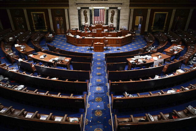 The House Chamber is empty after a hasty evacuation as rioters tried to break into the chamber at the U.S. Capitol on Wednesday, Jan. 6, 2021, in Washington. (AP Photo/J. Scott Applewhite)