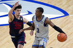 Saint Louis' Javonte Perkins (3) dribbles as Dayton's Mustapha Amzil (30) defends during the second half of an NCAA college basketball game Tuesday, Jan. 26, 2021, in St. Louis. (AP Photo/Jeff Roberson)