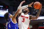 Dayton's Trey Landers (3) shoots against Drake's Anthony Murphy (4) during the first half of an NCAA college basketball game, Saturday, Dec. 14, 2019, in Dayton, Ohio. (AP Photo/John Minchillo)