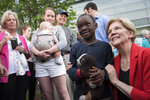 Democratic presidential candidate Sen. Elizabeth Warren, D-Mass., poses for a photo with Duke Okonda, 6, from Fairfax, Va., after addressing a campaign rally at George Mason University in Fairfax, Thursday, May 16, 2019. (AP Photo/Cliff Owen)