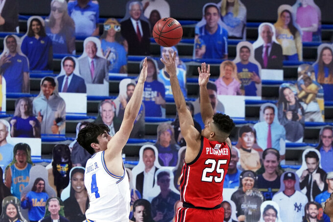 Utah guard Alfonso Plummer (25) shoots over UCLA guard Jaime Jaquez Jr. (4) during the second half of an NCAA college basketball game Thursday, Dec. 31, 2020, in Los Angeles. (AP Photo/Marcio Jose Sanchez)