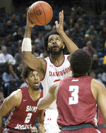 Davidson guard KiShawn Pritchett, center, goes to the basket against Saint Joseph's guard Jared Bynum (3) and forward Charlie Brown Jr. (2) during the first half of an NCAA college basketball game in the Atlantic 10 Conference tournament, Friday, March 15, 2019, in New York. (AP Photo/Mary Altaffer)