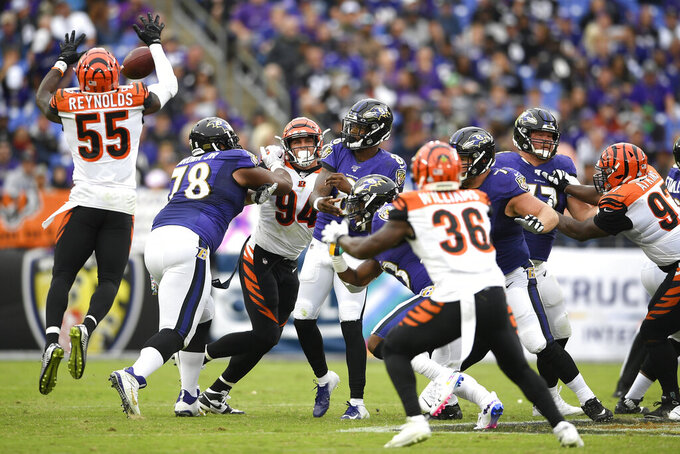 Cincinnati Bengals linebacker LaRoy Reynolds (55) blocks a pass from Baltimore Ravens quarterback Lamar Jackson, center, during the second half of a NFL football game Sunday, Oct. 13, 2019, in Baltimore. (AP Photo/Nick Wass)