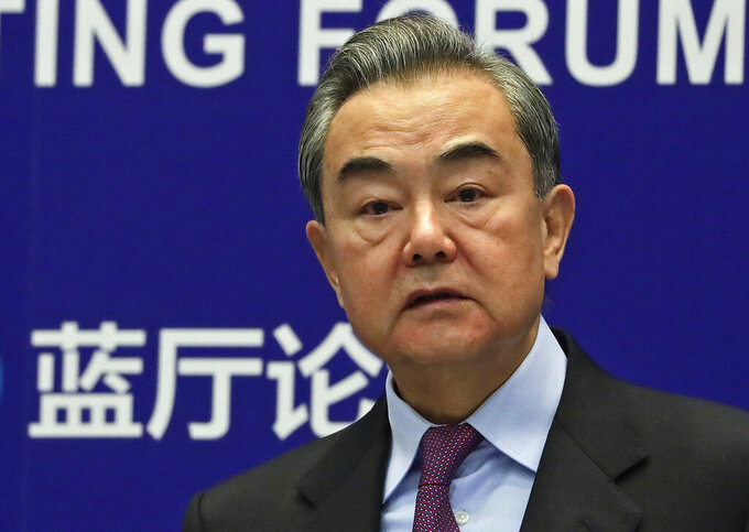 """FILE - In this Feb. 22, 2021, file photo, Chinese Foreign Minister Wang Yi delivers his opening remarks at the Lanting Forum on bringing China-U.S. relations back to the right track, at the Ministry of Foreign Affairs office in Beijing. According the the China Foreign Ministry, Yi has held a """"positive and constructive"""" virtual meeting Monday, Sept. 28, 2021, with NATO's chief Jens Stoltenberg  discussing the situation in Afghanistan, amid longstanding disagreements between Beijing and the U.S.-led alliance over regional policies. (AP Photo/Andy Wong, File)"""
