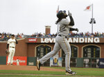 Pittsburgh Pirates' Josh Bell heads for home plate after hitting a home run off San Francisco Giants starting pitcher Andrew Suarez, left, during the second inning of a baseball game Thursday, Aug. 9, 2018, in San Francisco. (AP Photo/Eric Risberg)
