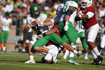 Oregon quarterback Justin Herbert (10) is sacked by Stanford linebacker Casey Toohill (52) during the first half of an NCAA college football game on Saturday, Sept. 21, 2019, in Stanford, Calif. (AP Photo/Tony Avelar)
