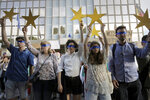 """Protesters hold EU stars and keep their eyes closed in front of the German Embassy in Sofia, Bulgaria, Wednesday, Aug. 12, 2020. Several hundred anti-government protesters gathered in front of Germany's embassy, calling on Berlin and Brussels to """"open their eyes"""" to widespread corruption in Bulgaria. During the peaceful protest, dubbed """"Eyes Wide Shut,"""" organizers complained that the European Union has willfully ignored the state of affairs in its poorest member state. (AP Photo/Valentina Petrova)"""