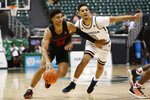 Houston guard Quentin Grimes (24) slips past Georgia Tech guard Michael Devoe (0) during the second half of an NCAA college basketball game Monday, Dec. 23, 2019, in Honolulu. (AP Photo/Marco Garcia)
