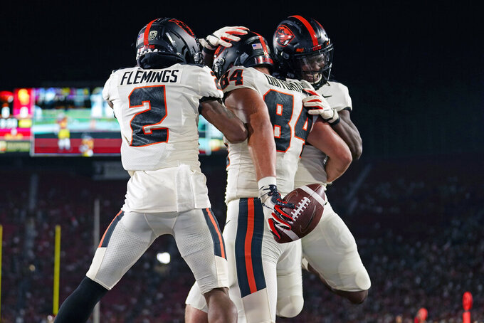 Oregon State tight end Teagan Quitoriano (84) celebrates his touchdown catch with Champ Flemings and Deshaun Fenwick during the first half of an NCAA college football game against Southern California Saturday, Sept. 25, 2021, in Los Angeles. (AP Photo/Marcio Jose Sanchez)