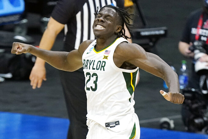 Baylor's Jonathan Tchamwa Tchatchoua celebrates after scoring against Hartford during the first half of a college basketball game in the first round of the NCAA tournament at Lucas Oil Stadium in Indianapolis Friday, March 19, 2021, in Indianapolis, Tenn. (AP Photo/Mark Humphrey)