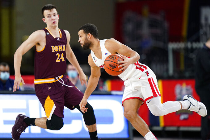 Fairfield's Jesus Cruz, right, tries to get past Iona's Dylan van Eyck in the first half of an NCAA college basketball game during the finals of the Metro Atlantic Athletic Conference tournament, Saturday, March 13, 2021, in Atlantic City, N.J. (AP Photo/Matt Slocum)