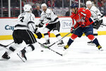 Washington Capitals left wing Alex Ovechkin (8), of Russia, skates with the puck in front of Los Angeles Kings defenseman Matt Roy (3) during the second period of an NHL hockey game Tuesday, Feb. 4, 2020, in Washington. (AP Photo/Nick Wass)