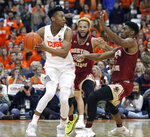 Syracuse's Tyus Battle, left, tries to pass the ball under pressure from Boston College's Ky Bowman, center, and Jared Hamilton, right, during the second half of an NCAA college basketball game in Syracuse, N.Y., Saturday, Feb. 9, 2019. Syracuse won 67-56. (AP Photo/Nick Lisi)