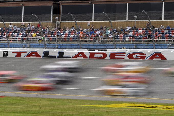 Cars race during a NASCAR Cup series auto race Monday, Oct. 4, 2021, in Talladega, Ala. (AP Photo/John Amis)