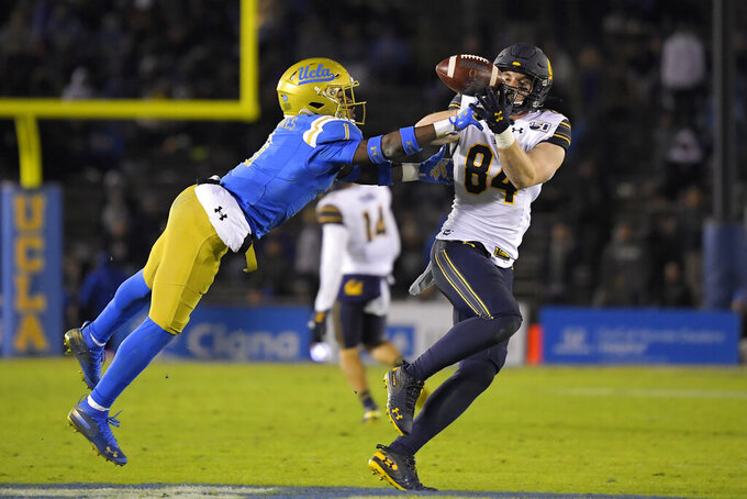 California tight end Gavin Reinwald, right, makes a catch as UCLA defensive back Darnay Holmes defends during the first half of an NCAA college football game Saturday, Nov. 30, 2019, in Pasadena, Calif. (AP Photo/Mark J. Terrill)