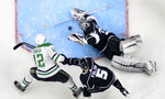 FILE - In this Feb. 22, 2018, file photo, Los Angeles Kings goaltender Jonathan Quick, right, stops a shot by Dallas Stars center Radek Faksa, left, of the Czech Republic, as defenseman Christian Folin, of Sweden, defends during the second period of an NHL hockey game in Los Angeles. The photo was part of a series of images by photographer Mark J. Terrill which won the Thomas V. diLustro best portfolio award for 2018 given out by the Associated Press Sports Editors during their annual winter meeting in in Lake Buena Vista, Fla. (AP Photo/Mark J. Terrill, File)