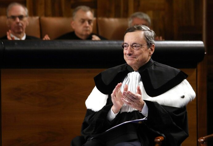 European Central Bank President Mario Draghi attends a ceremony where he was awarded an Honoris Causa Degree by the Rector of the Cattolica University Franco Anelli, in Milan, Italy, Friday, Oct. 11, 2019. (Matteo Bazzi/ANSA via AP)