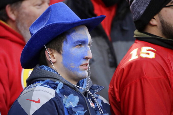 A Tennessee Titans fan watches during the second half of the NFL AFC Championship football game against the Kansas City Chiefs Sunday, Jan. 19, 2020, in Kansas City, MO. (AP Photo/Charlie Riedel)