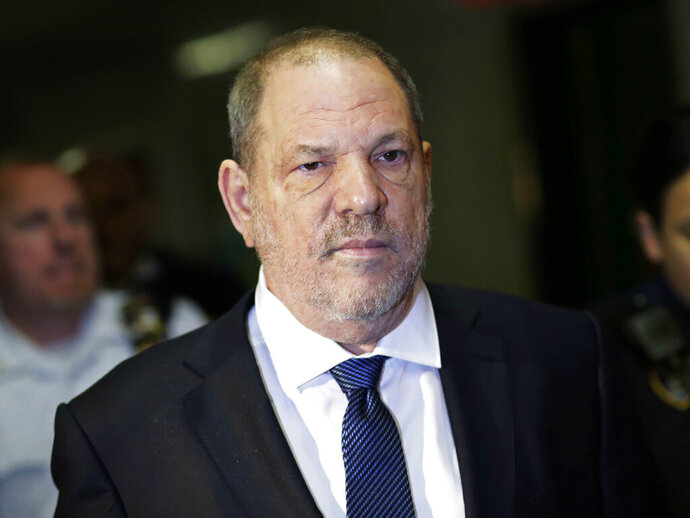 FILE - In this Oct. 11, 2018, file photo, Harvey Weinstein enters State Supreme Court in New York. Weinstein's lawyers want the trial over the sexual assault case against the disgraced movie mogul moved from New York City to Long Island or upstate New York because of a blizzard of pretrial publicity. An appeals court could rule on the request as early as Monday, Aug. 26, 2019. (AP Photo/Mark Lennihan, File)