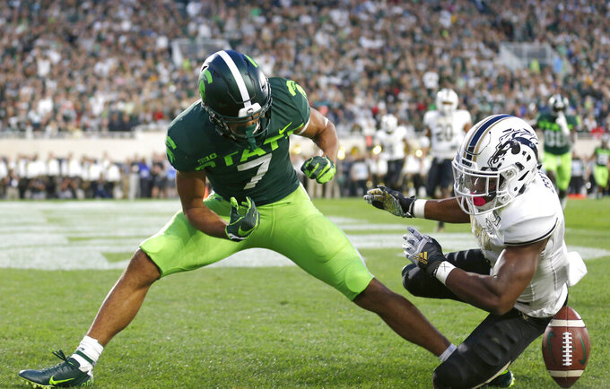 Western Michigan's D'Wayne Eskridge, right, breaks up a pass in the end zone intended for Michigan State's Cody White (7) during the first quarter of an NCAA college football game, Saturday, Sept. 7, 2019, in East Lansing, Mich. (AP Photo/Al Goldis)