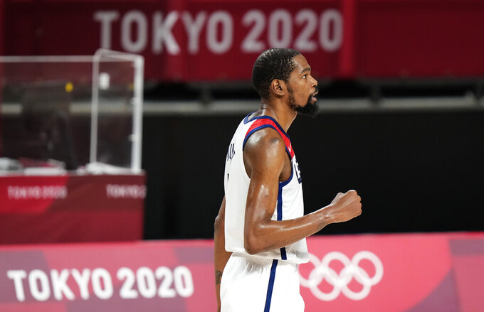 United States' Kevin Durant (7) celebrates a score during men's basketball gold medal game against France at the 2020 Summer Olympics, Saturday, Aug. 7, 2021, in Saitama, Japan. (AP Photo/Luca Bruno)