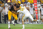 Arizona State linebacker Merlin Robertson (8) sacks Kent State quarterback Dustin Crum (14) during the first half of an NCAA college football game Thursday, Aug. 29, 2019, in Tempe, Ariz. (AP Photo/Ralph Freso)