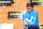 Richard Carapaz celebrates on the podium after winning the 14th stage of the Giro d'Italia cycling race, from Saint-Vincent to Courmayeur, Saturday, May 25, 2019. Richard Carapaz of Ecuador won the grueling 14th stage of the Giro d'Italia on Saturday to move into the overall lead. (Alessandro Di Meo/ANSA via AP)