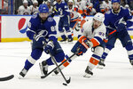 Tampa Bay Lightning right wing Nikita Kucherov (86) beat New York Islanders center Casey Cizikas (53) to the puck during the second period in Game 2 of an NHL hockey Stanley Cup semifinal playoff series Tuesday, June 15, 2021, in Tampa, Fla. (AP Photo/Chris O'Meara)