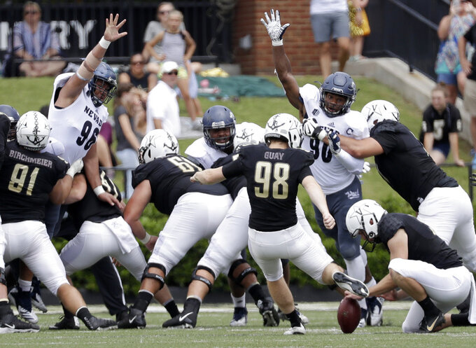 Vanderbilt place kicker Ryley Guay (98) kicks a 35-yard field goal against Nevada in the first half of an NCAA college football game Saturday, Sept. 8, 2018, in Nashville, Tenn. (AP Photo/Mark Humphrey)