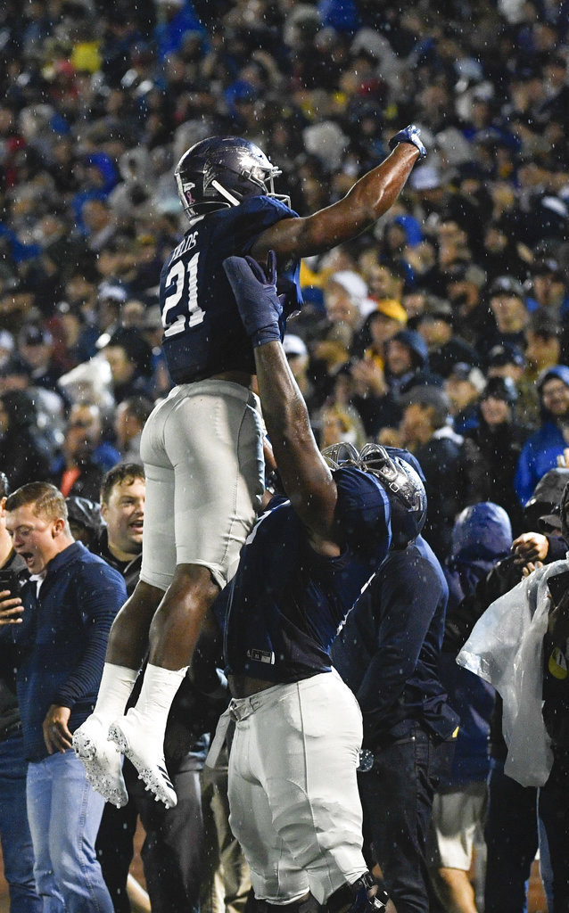 Georgia Southern running back Wesley Fields (21) is lifted in celebration of his touchdown during the first half of an NCAA college football game against Appalachian State, Thursday, Oct. 25, 2018, in Statesboro, Ga. (AP Photo/John Amis)