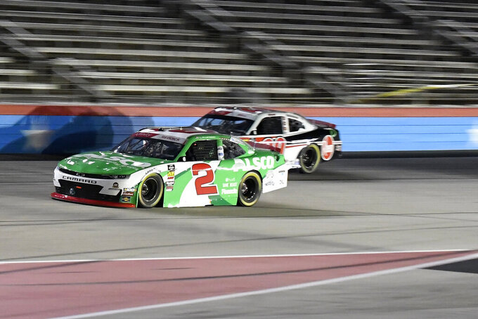Tyler Reddick (2) and Christopher Bell, rear, come out of Turn 4 during NASCAR Xfinity auto race at Texas Motor Speedway in Fort Worth, Texas, Saturday, Nov. 2, 2019. (AP Photo/Randy Holt)