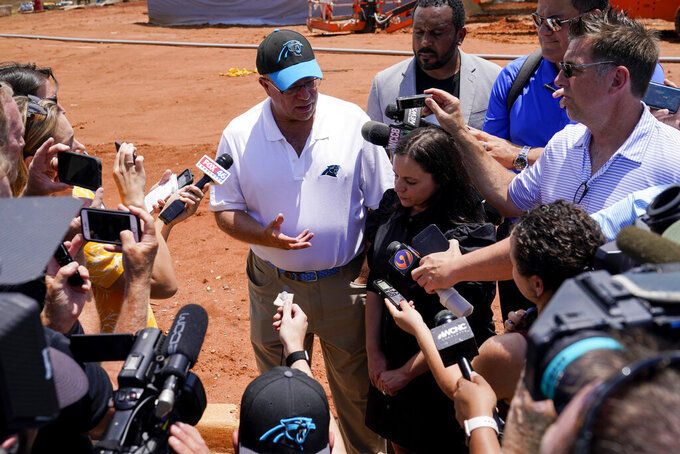 Carolina Panthers owner David Tepper and his wife Nicole, talk to the media after announcing a donation to Miracle Park on Tuesday, June 8, 2021, in Rock Hill, S.C. Tepper said he is no longer considering building a domed stadium in downtown Charlotte. (AP Photo/Chris Carlson)