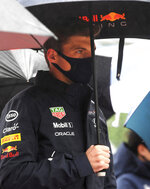 Red Bull driver Max Verstappen of the Netherlands stands under an umbrella prior to the Formula One Grand Prix at the Spa-Francorchamps racetrack in Spa, Belgium, Sunday, Aug. 29, 2021. (John Thys, Pool Photo via AP)