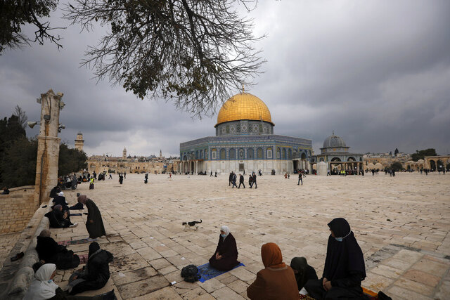 Muslims gather for Friday prayer, next to the Dome of the Rock Mosque in the Al Aqsa Mosque compound in Jerusalem's old city, Friday, Nov. 6, 2020. The Palestinian leadership has condemned the United Arab Emirates' decision to forge ties with Israel as a