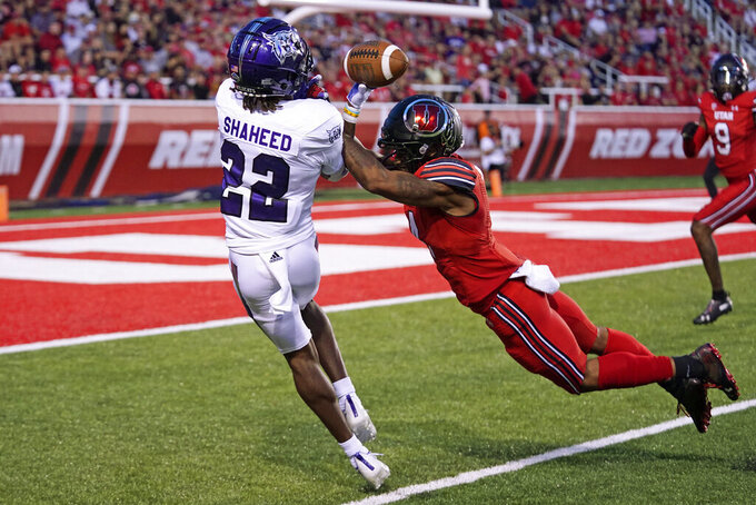 Utah cornerback JaTravis Broughton, right, breaks up a pass to Weber State wide receiver Rashid Shaheed (22) during the first half of an NCAA college football game Thursday, Sept. 2, 2021, in Salt Lake City. (AP Photo/Rick Bowmer)