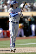 Texas Rangers' Jonah Heim (28) watches his two-run home run in the eighth inning of a baseball game against the Oakland Athletics, Saturday, Sept. 11, 2021, in Oakland. (AP Photo/Scot Tucker)
