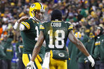 FILE - In this Jan. 8, 2017, file photo, Green Bay Packers quarterback Aaron Rodgers (12) and wide receiver Randall Cobb (18) celebrate after a touchdown during the second half of an NFC wild-card NFL football game against the New York Giants, in Green Bay, Wis. Randall Cobb still talks to his old quarterback regularly despite the receiver's move to the Dallas Cowboys after spending his first eight seasons with Aaron Rodgers and the Green Bay Packers. While Cobb hadn't spoken to Rodgers as of the middle of the week leading to their first game against each other Sunday, the trusty slot man didn't seem too hung up on avoiding contact. (AP Photo/Mike Roemer, File)