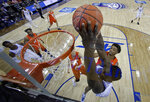 Duke's Zion Williamson, right, dunks against Syracuse during the second half of an NCAA college basketball game in the Atlantic Coast Conference tournament in Charlotte, N.C., Friday, March 15, 2019. (AP Photo/Chuck Burton)