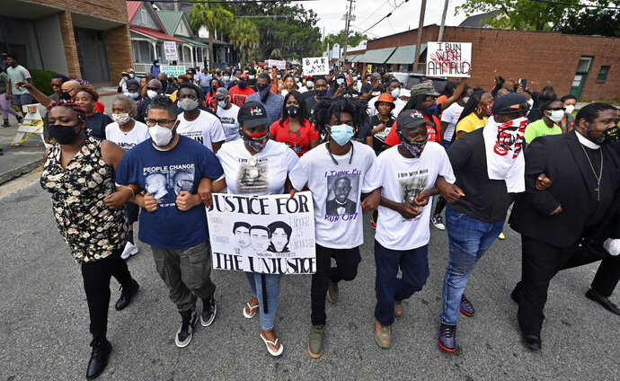 Protesters march after a rally at the Glynn County Courthouse to protest the shooting of Ahmaud Arbery, Saturday, May 16, 2020, in Brunswick, Ga. (Hyosub Shin/Atlanta Journal-Constitution via AP)