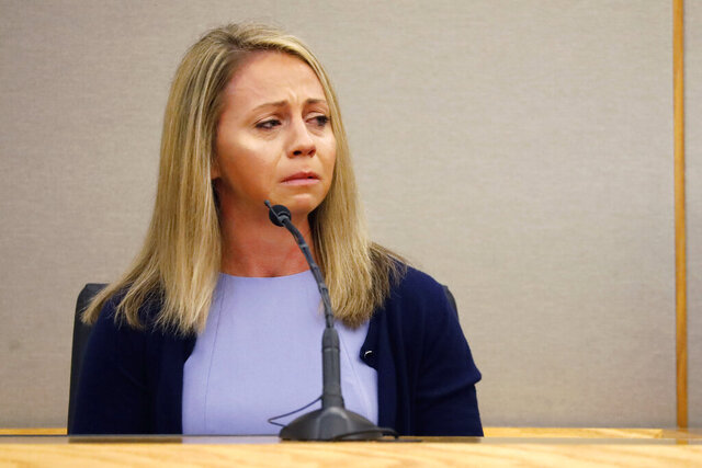 FILE - In this Sept. 27, 2019, file photo, fired Dallas police officer Amber Guyger becomes emotional as she testifies in her murder trial in Dallas. A federal judge has ruled the city of Dallas is not liable for the off-duty police officer fatally shooting a man in his own apartment last year. On Monday, Dec. 23, 2019 U.S. District Judge Barbara Lynn dismissed the city from civil lawsuit that the family of Botham Jean brought after the 26-year-old was killed by Guyger. (Tom Fox/The Dallas Morning News via AP, Pool, File)