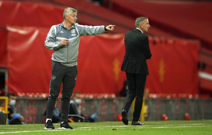 Manchester United's manager Ole Gunnar Solskjaer gestures during the Europa League round of 16 second leg soccer match between Manchester United and LASK at Old Trafford in Manchester, England, Wednesday, Aug. 5, 2020. (AP Photo/Dave Thompson)