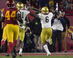 Notre Dame running back Tony Jones Jr., right, celebrates as he runs in for a touchdown as Southern California defensive lineman Malik Dorton gives chase during the second half of an NCAA college football game Saturday, Nov. 24, 2018, in Los Angeles. Notre Dame won 24-17. (AP Photo/Mark J. Terrill)