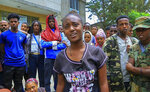 """In this image from video, student Meron Mezge, 16, explains why she is trying to join the Tigray forces, as she an others gather outside the security bureau in Mekele, in the Tigray region of northern Ethiopia on Tuesday, July 6, 2021. """"I came here because I saw girls like me being raped"""" by combatants, she said. """"I actually wanted to go (fight) at the beginning but I was told I was too young. But because I saw my comrades come, I came here to fight alongside them."""" (AP Photo)"""