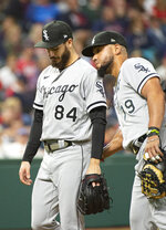Chicago White Sox starting pitcher Dylan Cease (84) gets a pat from Jose Abreu after getting hit by a ball off the bat of Cleveland Indians' Bradley Zimmer during the sixth inning of a baseball game in Cleveland, Friday, Sept. 24, 2021. (AP Photo/Phil Long)